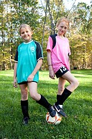Two Young Girls With Soccer Ball, Portrait