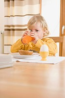 Girl drinking juice in breakfast (thumbnail)