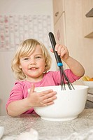 Girl mixing cake ingredients in bowl