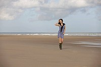 France, Pas_de_Calais, Escalles, Young woman strolling on empty beach