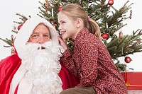 Girl with Santa Claus, smiling