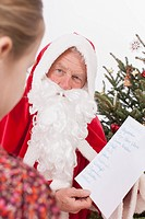 Santa claus showing list to girl
