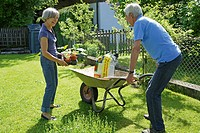 Germany, Bavaria, Senior couple gardening plants