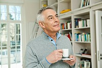 Germany, Berlin, Senior man with coffee cup