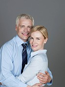 Mature couple embracing each other, smiling, portrait