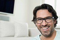 Germany, Berlin, Mature man with spectacles, smiling, portrait