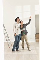 Germany, Berlin, Mature couple inspecting new house