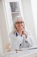 Portrait of senior female doctor