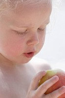 Germany, Bavaria, Girl eating apple, close up