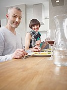 Germany, Cologne, Man and woman having dinner, smiling