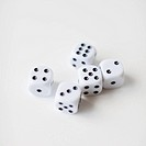 Dices on white background, studio shot