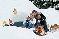 Austria, Salzburg County, Couple sitting near fireplace (thumbnail)