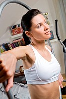 Woman doing exercises with a hoop.