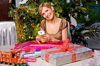 Woman packing Christmas presents.