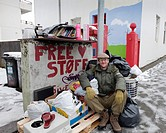 Man on street offering miscellaneous items for free, Reykjavik, Iceland