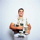 Man Holding Trophies