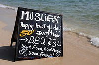 Advertising board for a restaurant on a beach, Ochheuteal Beach, Sihanoukeville, Cambodia, Asia