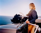 Woman Standing on Car and Looking at View