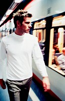 Man Walking on Train Platform