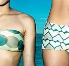 Two women wearing bikinis