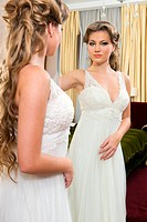 Beautiful bride at the mirror
