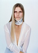 Blond young woman with long hair and a neck brace