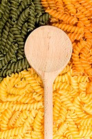Wooden spoon, green and yellow noodles