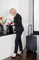 Elegant woman with baggage holding keyring