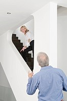 Senior couple at home on staircase (thumbnail)