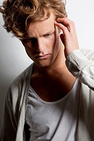 Pensive young man with curly hair