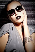 Young woman with lipstick and sunglasses