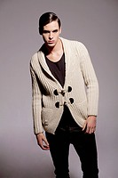 Young man wearing cardigan