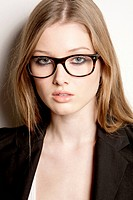 Teenage girl wearing eyeglasses and blazer