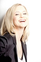 Happy young woman wearing blazer