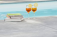 Two cocktails and books at the poolside