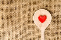 Red heart on a wooden spoon
