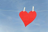 Red heart hanging on clothesline (thumbnail)