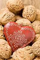 Ornate heart among walnuts