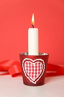 Burning candle with heart_shaped candle holders