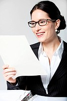 Smiling businesswoman reading document
