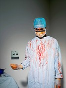 Surgeon Holding Scalpel