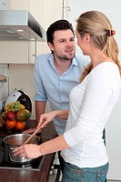 Couple cooking together in kitchen