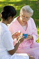 Nurse Helping Senior Patient with Medication