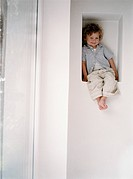 Smiling Toddler Sitting in Alcove