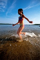 Small Girl Running in Sea