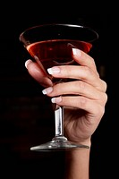 Woman Holding Red Martini
