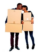 Couple holding cardboard boxes and kissing