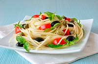 Spaghetti with tomato, capers and basil with olives