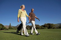 Couple Walking Along Golf Course