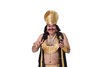 Man dressed as Raavan listening to music